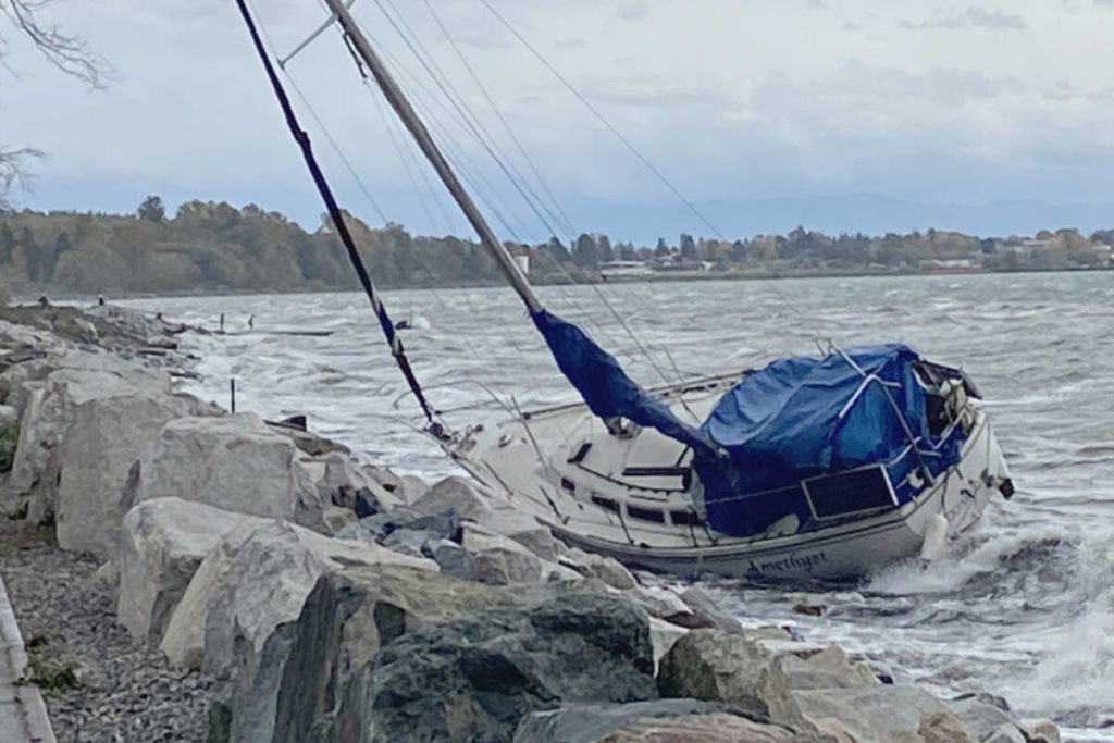 PHOTOS: U.S. sailboat runs aground on White Rock beach during windstorm - Peace Arch News